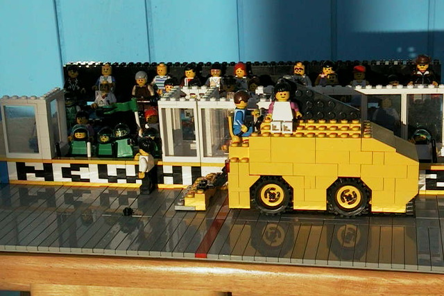 Lego Zamboni cleans in front of Players Bench & Fans