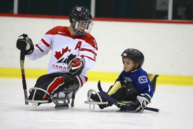 Sledge Hockey - Young Boy Learning to play with Team Canada