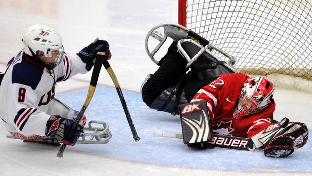 Sledge Hockey Usa Greg Shaw Shoots Benoit St Amand Of Canada