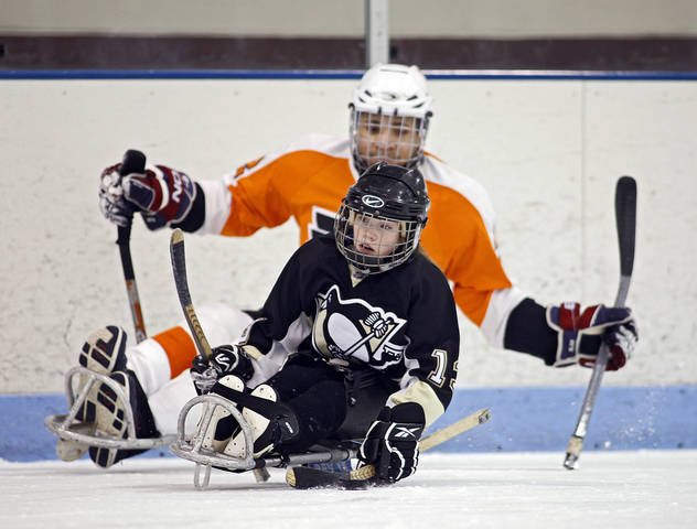 Sledge Hockey - Children learning the game at practice
