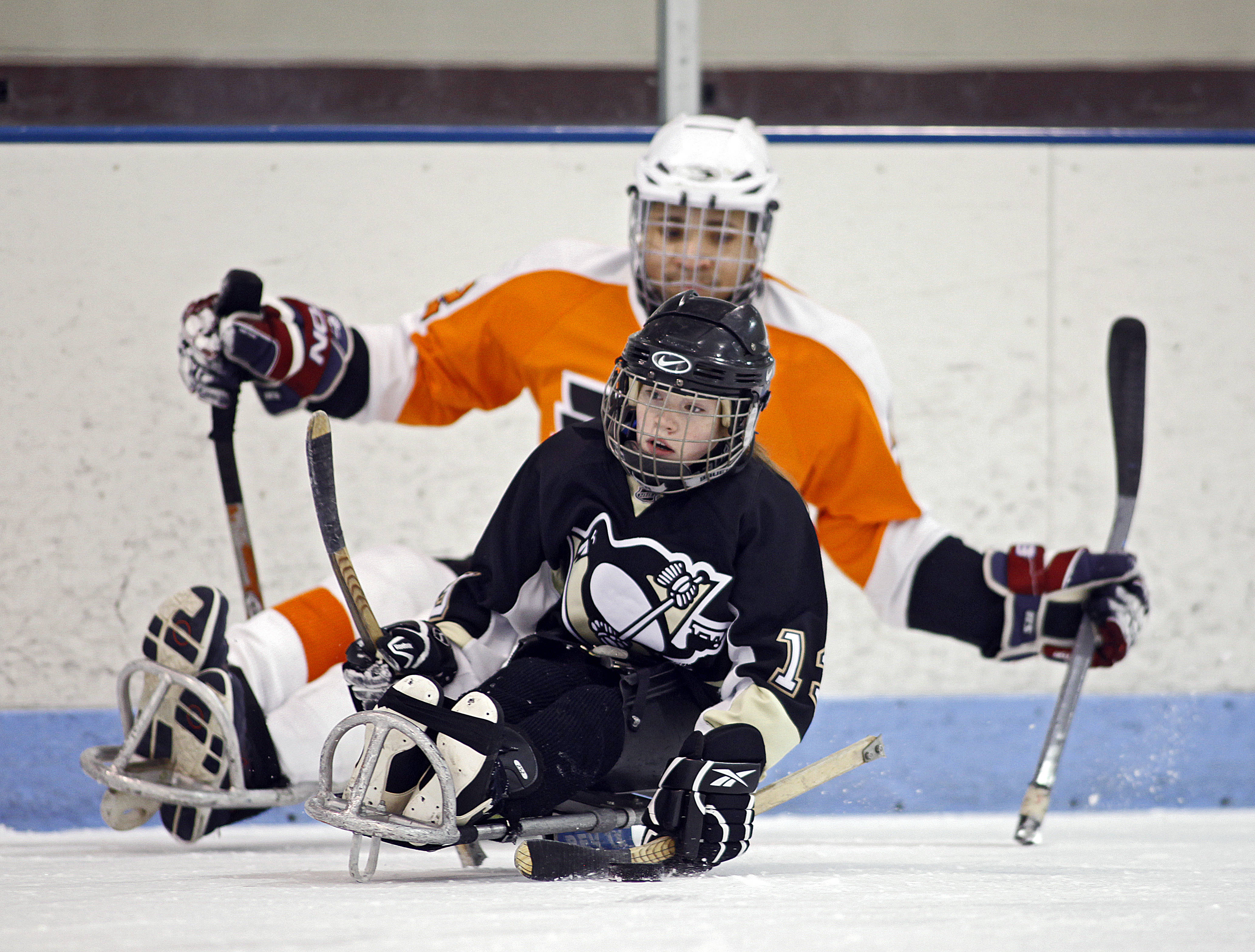 Sledge Hockey - Children learning the game at practice ...