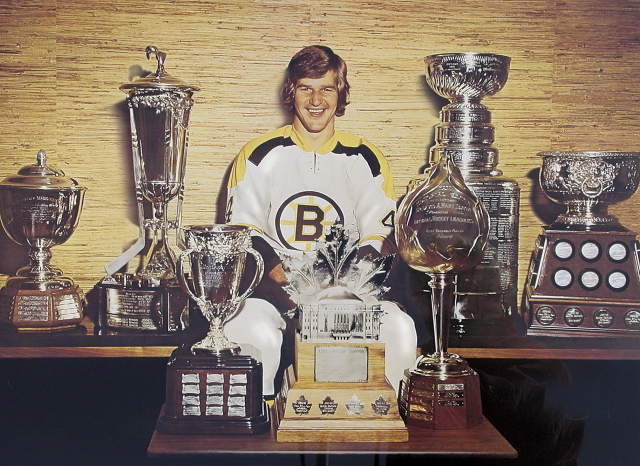 Bobby Orr with the collection of NHL Trophy's he has won - 1970s