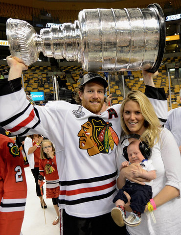 Duncan Keith with wife Kelly-Rae & Stanley Cup Baby Duncan 2013