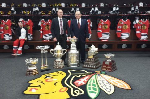 Stan & Scotty Bowman with the 6 NHL trophies the Blackhawks Won