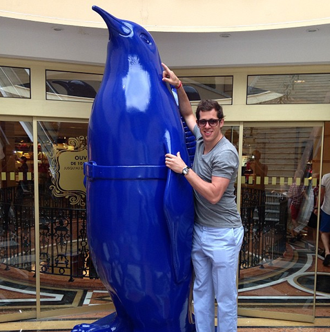 Evgeni Malkin Standing Next To A Big Blue Penguin