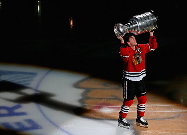 Jonathan Toews lifts Stanley Cup - Chicago Banner Raising - 2013
