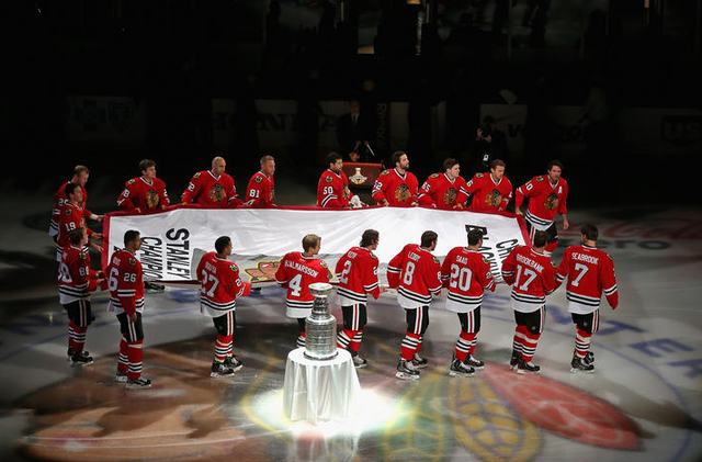 Chicago Blackhawks Carry Championship Banner Past Stanley Cup