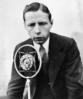 Foster Hewitt at microphone for Hockey radio broadcast in 1930s