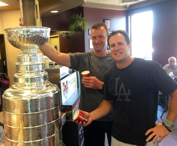 Rob Blake Pouring Timbits into Stanley Cup with Nelson Emerson