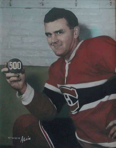 Rocket Richard / Maurice Richard with his 500 Goal Puck 1957