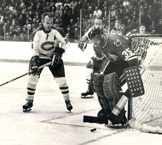 Tony Esposito makes save from Henri Richard 1969