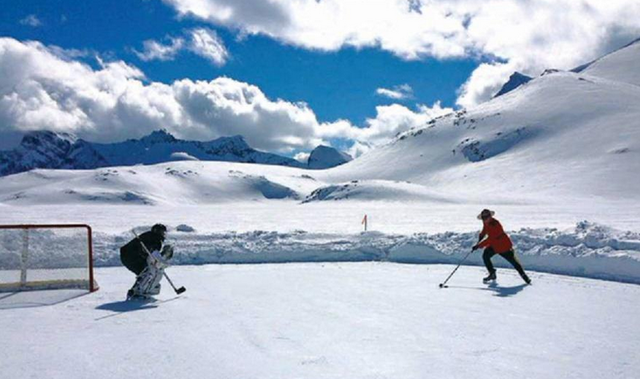 RCMP in Full Uniform Playing Pond Hockey on Purcell Glacier 2015