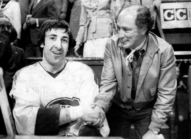 Guy Lapointe accepts Congrats Handshake from Pierre Trudeau 1976