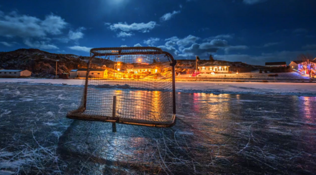 Hockey net reflecting on the pond in Labrador