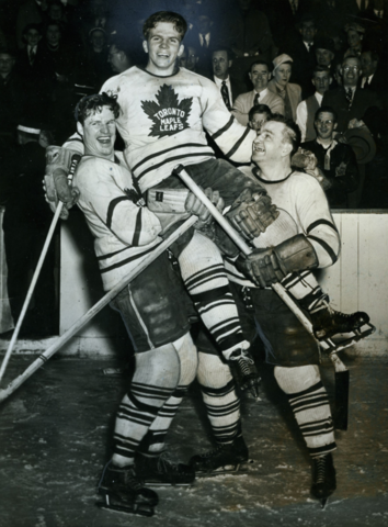 Toronto Maple Leafs Bill Barilko gets lifted by Cal Gardner and Bill Juzda 1951