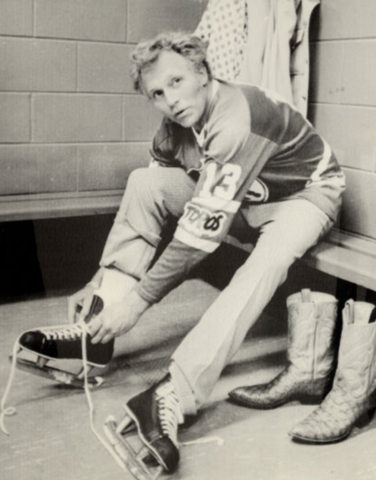 Evel Knievel lacing up his Hockey skates in the Toronto Toros dressing room 1975