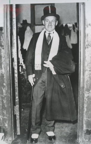 Conn Smythe at the Toronto Maple Leafs dressing room in a Tophat & Spats in 1937