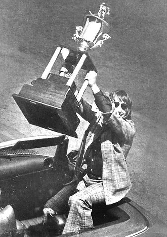Galen Head, captain of the Johnstown Jets lifts the Lockhart Cup 1975