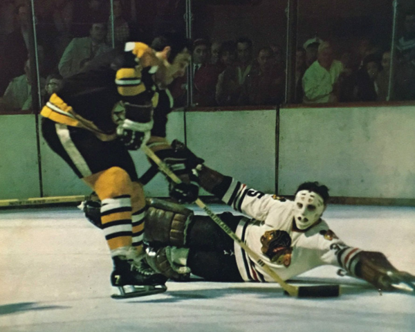 Boston Bruins Phil Esposito scores on brother Chicago Black Hawks Tony Esposito
