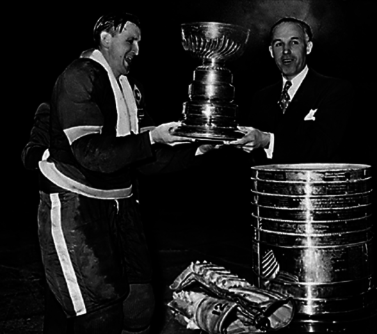 Detroit Red Wings Sid Abel accepts the 1943 Stanley Cup from Clarence Campbell