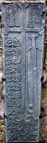 The Clonca Graveslab on the Isle of Iona with a Caman & Sliothar 15th Century