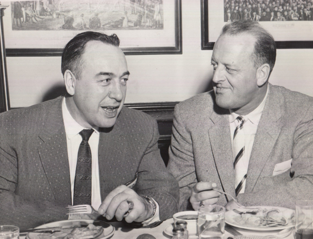 Toe Blake and Lynn Patrick talk a little Hockey over dinner 1957