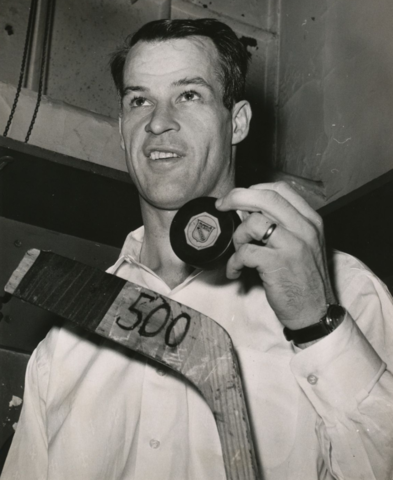 Gordie Howe with 500 Goal Puck and Stick - March 14, 1962
