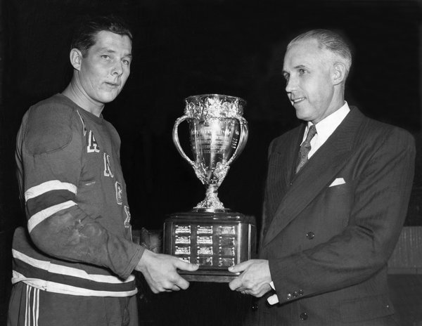 Pentti Lund receives the 1949 Calder Memorial Trophy from Clarence Campbell