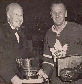 Johnny Bower accepts the 1960 J. P. Bickell Memorial Award from Keiller Mackay