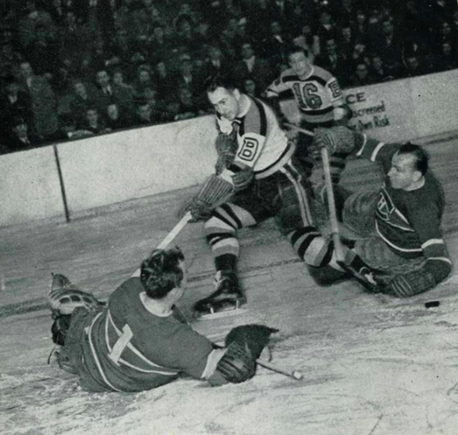 Bill Durnan of Canadiens makes save vs Knobby Warwick of Bruins 1947