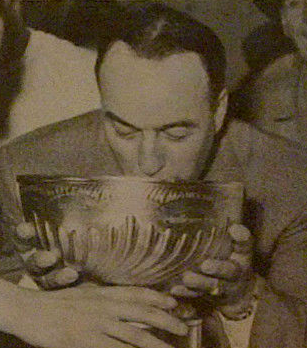 Toe Blake drinks from The Stanley Cup 1960