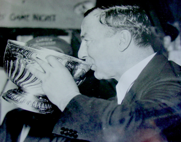 Art Ross drinks from the Stanley Cup Bowl 1939
