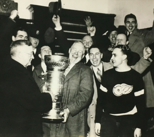 Frank Calder Presents 1937 Stanley Cup to Detroit Red Wings Coach Jack Adams