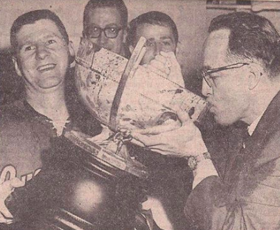 Portland Buckaroos Coach Hal Laycoe drinks from Lester Patrick Cup 1965