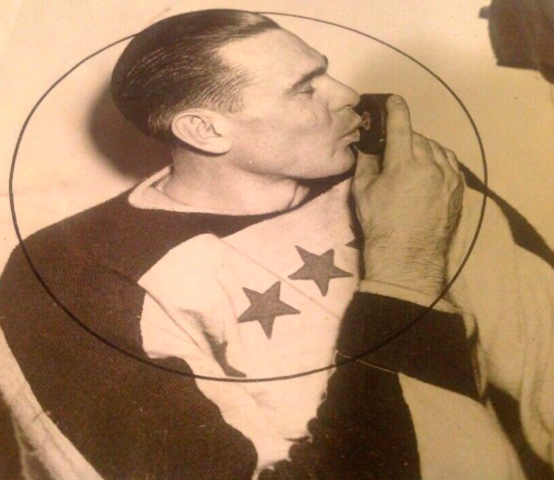 Lorne Carr Kisses the Puck after he scored winning goal in 4th overtime 1938