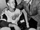 Gordie Howe is congratulated by coach Sid Abel on his 1,000th NHL Game 1961