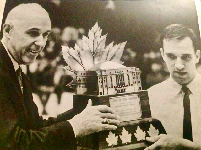Clarence Campbell presents 1966 Conn Smythe Trophy Winner Roger Crozier