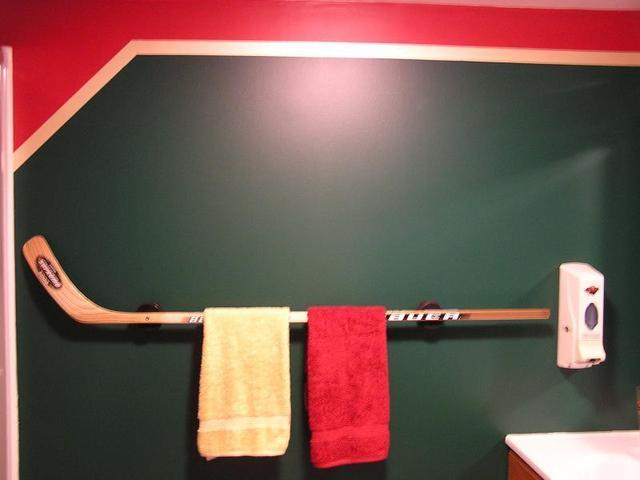 Hockey stick towel bar hockeygods for Sports themed bathroom ideas