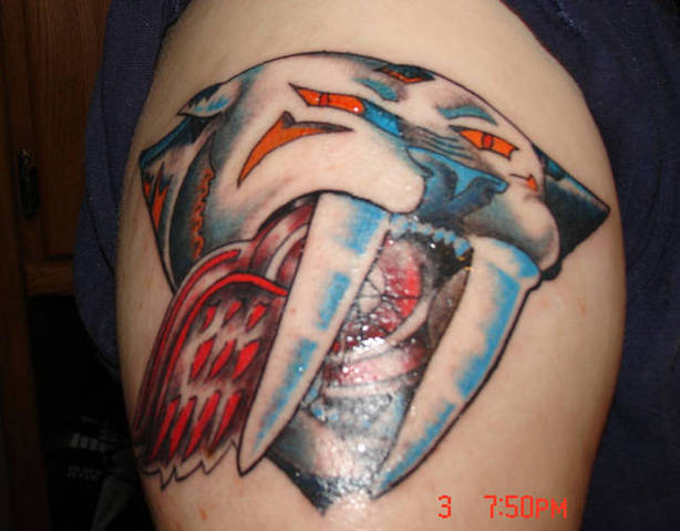 Nashville Predators Tattoo eating a Red Wing