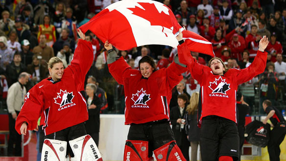 Team Canada waving the Canadian Flag at Winter Olympics