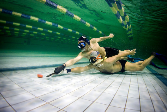 Underwater Hockey Battle for Puck