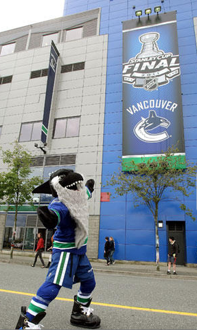 Fin outside Rogers Arena with Stanley Cup Playoff Banner 2011