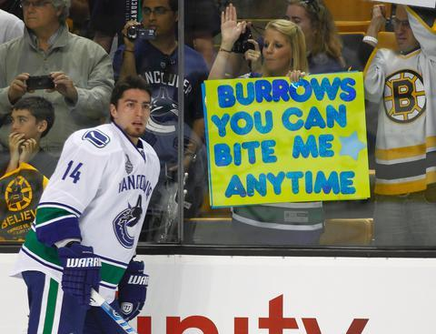 Alex Burrows and a Fan with a Bite Me sign