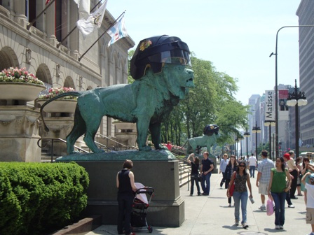Large Lions in Chicago sporting black Ice Hockey Helmets
