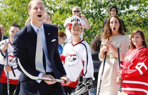 Prince William and Kate going Ohhh, during a Street Hockey shot