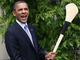 Barack Obama holds a Hurling Stick