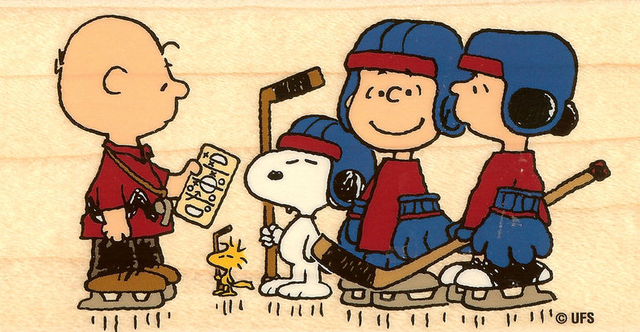 Snoopy & Charlie Brown getting ready to play Ice Hockey