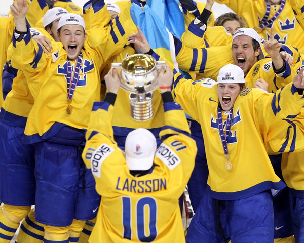 World Championship Trophy being skated to Sweden Teammates