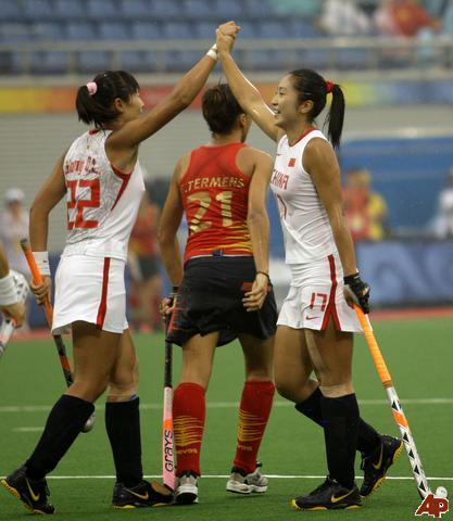 China's Li Hongxia 17 celebrates with her teammate Song Qingling