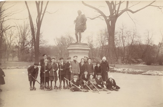 Street Hockey - Young Men Pose For a Group Photo Beside Statue